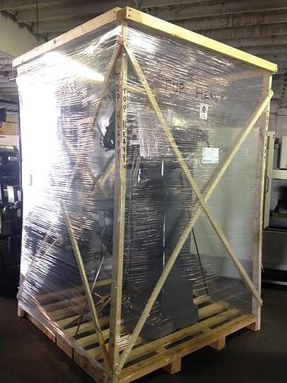 shrink-wrapped shipping crate
